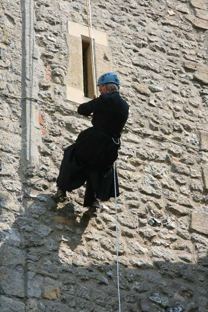 Canon Sue Booys abseils down the tower in 2011