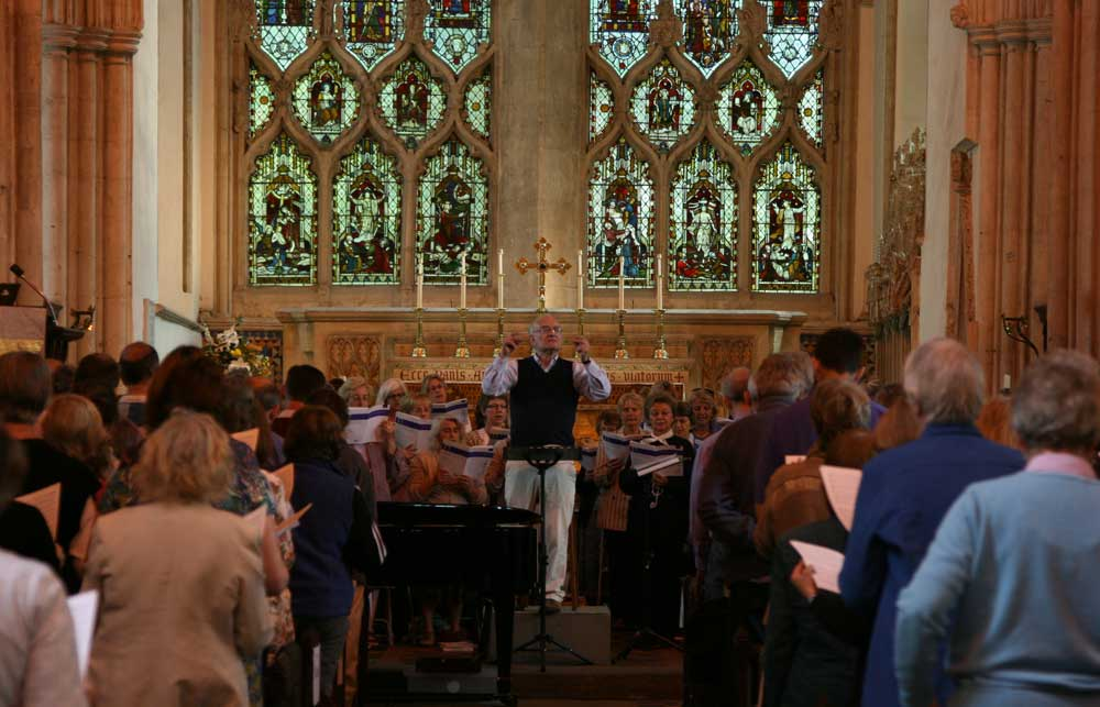 John Rutter conducts a packed Come & Sing in 2011